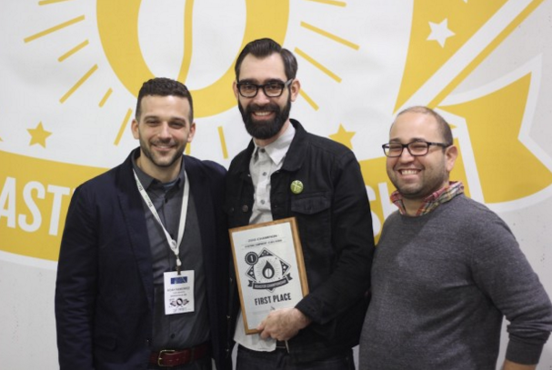 Querio, center, with Noah Namaowicz and Piero Cristiani of Cafe Imports. Photo credit Daily Coffee News.