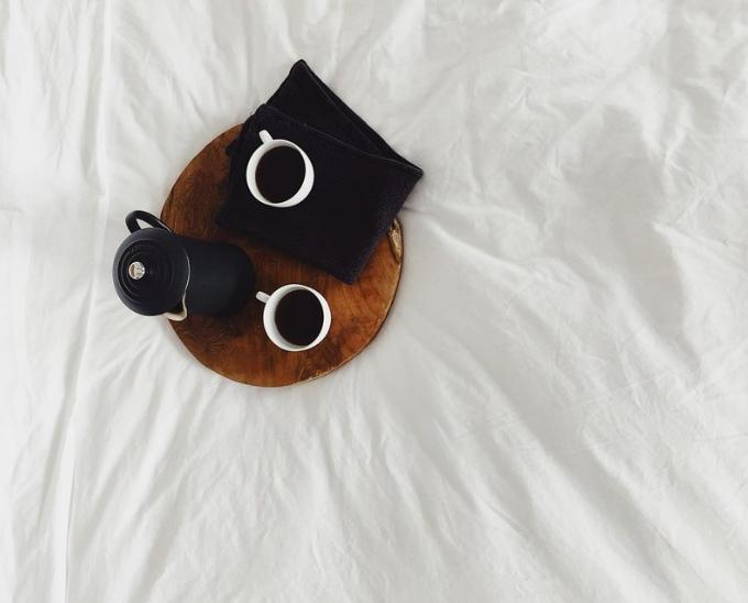 2 cups of dark roast drip coffee in bed